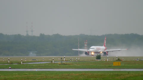 Airplane taxiing at rainy weather Live Action