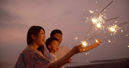 happy family celebrating new year with sparklers Live Action