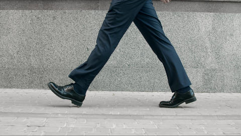Business man legs walking in black shoes. Closeup black shoes walking outdoor Live Action