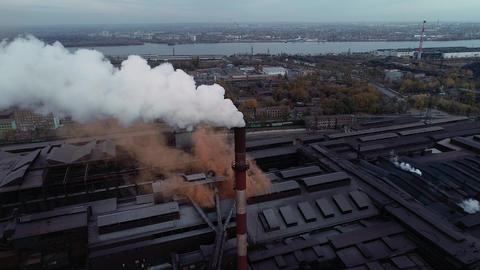 Industrial area with white and orange toxic smoke Live Action