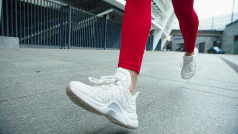 Close up female legs running on urban street. Woman legs jogging outdoor Live Action
