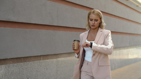 Closeup woman walking at street. Woman watching time on smart watch outdoor Live Action