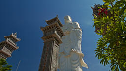 Large White Marble Buddha Statue High Columns in Temple Park Footage