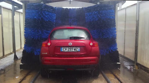 Car in Automatic Car Wash - Rear View Footage