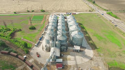 Steel grain silos elevators storage 4k aerial video. Agriculture industry Footage