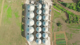 Steel grain silos elevator storage 4k aerial top view video Agriculture industry Footage