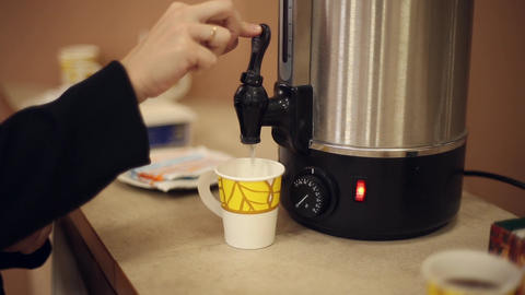 Pour boiling water from a thermos Live Action