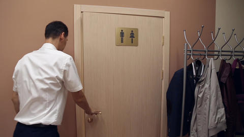 A man enters the toilet Footage