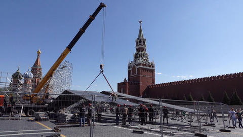 Mobile crane lift part of detachable construction after event on Red Square Live Action