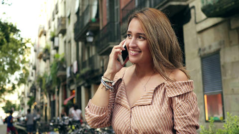 Portrait of cheerful woman talking smartphone. positive woman chatting cellphone Live Action