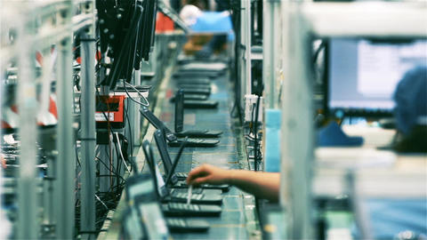 Assembly Line Workers Making Laptops Computers in a Factory Live Action