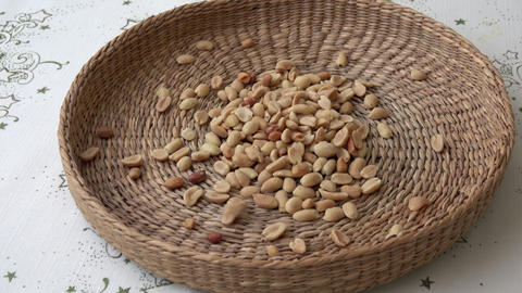 Many peanuts. There are nuts in the basket Live Action