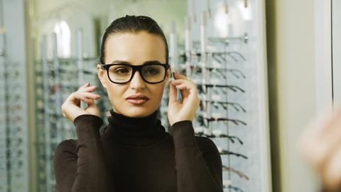 Woman choosing eyeglasses Live Action