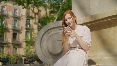 Portrait of young woman looking mobile phone. Pretty woman texting cellphone Live Action