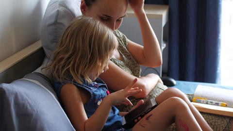 Mom and daughter communicate via video link with relatives Live Action
