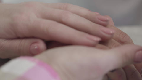 Extreme close-up of Caucasian female hands caressing friend's hand. Friendship Live Action
