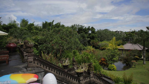 Massive garden with lots of trees and plants, traditional statues, Bali Live Action
