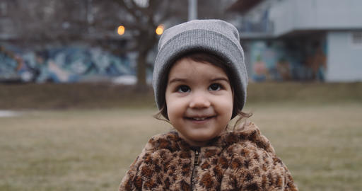 Toddler girl playing outside in a Toronto park Live Action