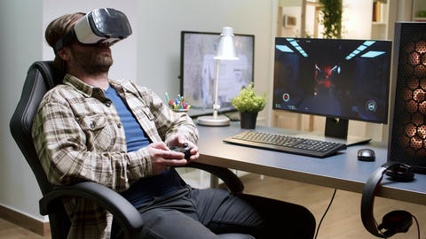 Game over for man sitting on gaming chair using vr headset Live Action