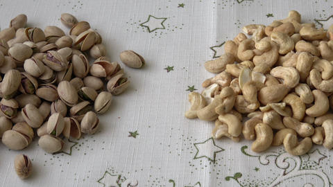 Many pistachios and cashew nuts Live Action