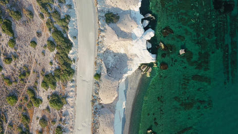 Overhead rocky sea shore with crystal clear water Live Action