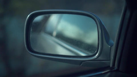 Side mirror of a car. Reflection of the image of the side mirror of the car Live Action