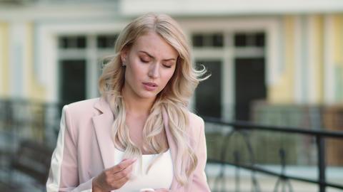 Portrait woman talking by wireless headset. Girl using wireless earbuds Live Action