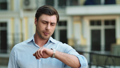 Closeup businessman waiting at street. Businessman checking time on wrist watch Live Action