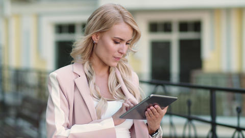 Closeup woman using touchpad at street. Woman using…, Live Action