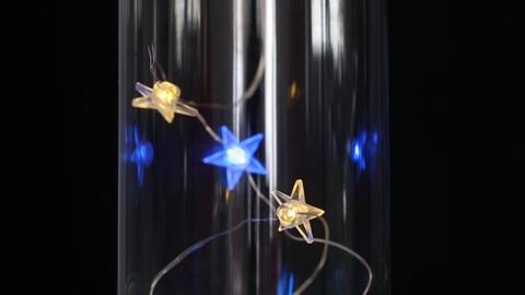 Festival decorative string star lights putting on the glass vase at night. Warm lighting, vintage Live Action