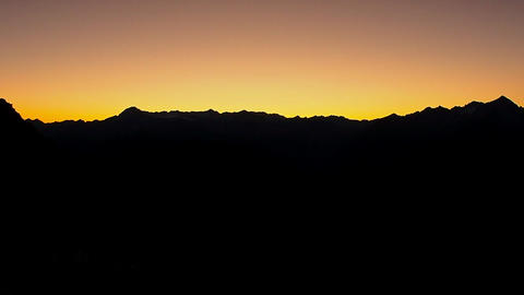 Dark Silhouette of Mountains and sunset. Mountain peaks Dolomites. Brenta, Italy Live Action