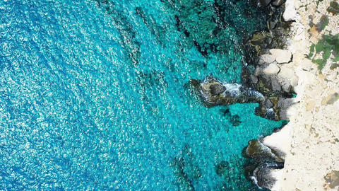 Overhead view of a rocky shoreline of mediterranean sea Live Action