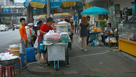 BANGKOK. THAILAND - CIRCA FEB 2015: Local Street Vendors Selling their Products Footage