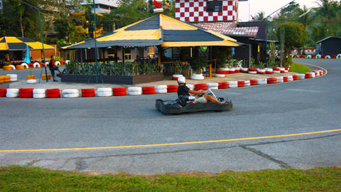 PHUKET. THAILAND - CIRCA FEB 2015: Tourist rushes around a turn in a go-cart at Footage