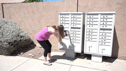 Young Pregnant Woman Gets Her Mail from the Mailbox Footage