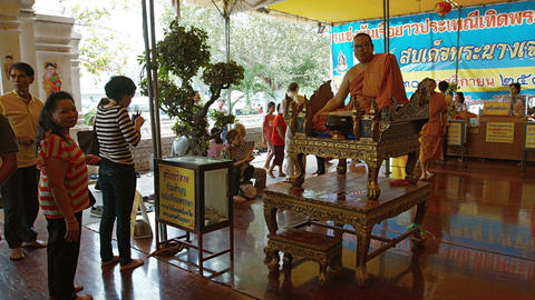 AYUTHAYA. THAILAND - CIRCA FEB 2015: Buddhist worshippers giving offerings to a Footage