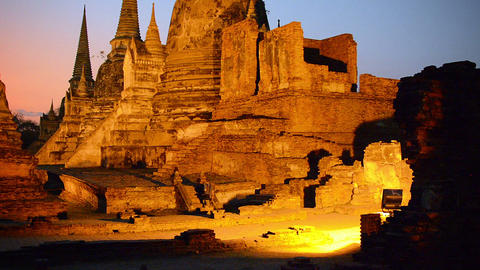 Artificial Lighting Casts a Strange Light over Ancient Stupas at Wat Phra Si San Footage