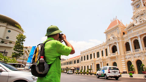 Old Man in Hat Photos Ho Chi Minh City Hall from across Street Footage