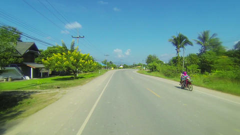 THAILAND - CIRCA DEC 2013: Cruising along a rural highway in Thailand. from a pa Live Action