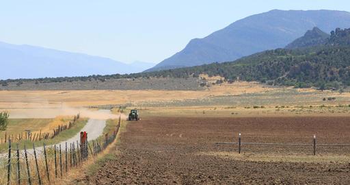 Tractor farm dusty desert field drought DCI 4K Footage