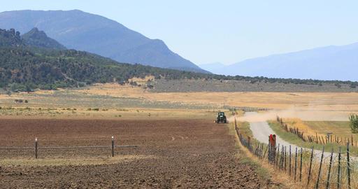 Tractor farm dusty mountain desert field drought DCI 4K Footage