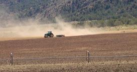 Hot desert mountain valley tractor dusty farm DCI 4K Footage