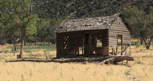 Old pioneer homestead abandoned mountain valley pan DCI 4K Footage