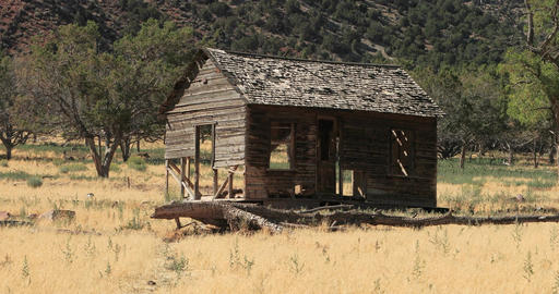 Old pioneer homestead abandoned pan mountain valley DCi 4K Footage
