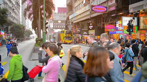 HONG KONG. CHINA - CIRCA JAN 2015: Swarm of pedestrians crossing a major city st Footage