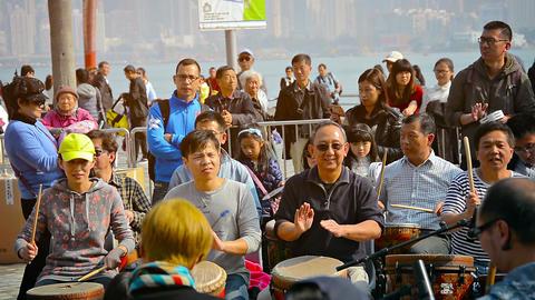 HONG KONG. CHINA - CIRCA JAN 2015: Tourists beating out rhythms on percussian in Live Action
