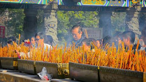 HONG KONG. CHINA - CIRCA JAN 2015: Hundreds of incense sticks smolder as worship Footage