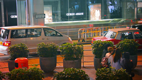 HONG KONG. CHINA - CIRCA JAN 2015: Busy. evening traffic along Chater Road in do Footage