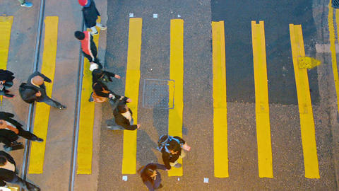HONG KONG. CHINA - CIRCA JAN 2015: Pedestrians crossing a busy. city street at a Footage