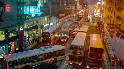 HONG KONG. CHINA - CIRCA JAN 2015: Buses temporarily jam the busy nighttime traf Footage